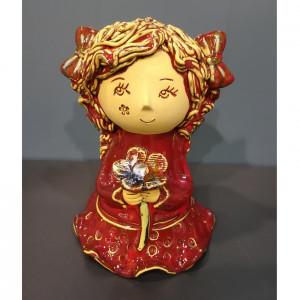 Angeliukas mergaitė su gėlyte raudona