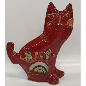 Katinukas riestauodegis su paukščiu raudonas